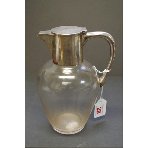 28 - <strong>A silver mounted glass claret jug, </strong><em>by John Grinsell &amp; Sons, </em>Birmingham...