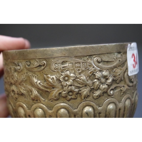 34 - <strong>A Victorian silver embossed slop bowl,</strong> <em>by</em><em>W</em><em>alter &amp; Charle...