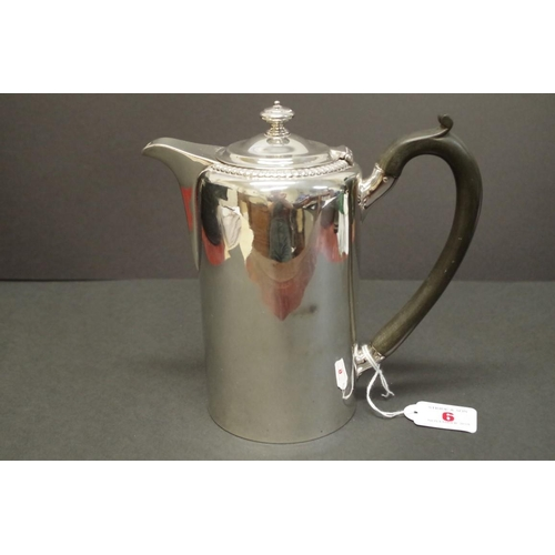 6 - <strong>A George III silver hot water jug,</strong> <em>marks indistinct, by Robert Garrard?,</em> L...