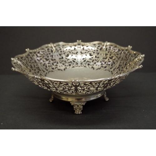 8 - <strong>A pierced silver fruit stand</strong>, <em>by Barker Bros Silver Ltd,</em> Birmingham 1930, ...