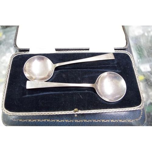 20 - <strong>A cased set of six teaspoons,</strong> <em>by Roberts &amp; Belk</em>, Sheffield 1935; toget...