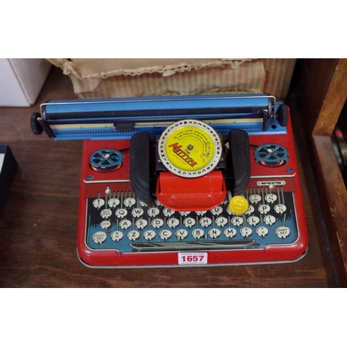 1182 - <strong>A vintage Mettype tinplate toy typewriter, </strong>in original box; together with a no...