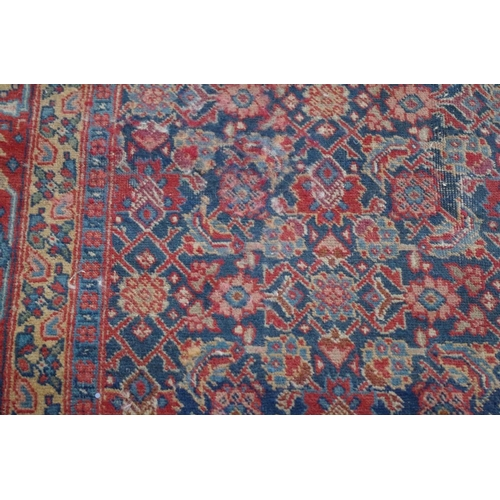 1043 - <strong>A North West Persianrug</strong>,having allover floral decoration, 185 x 140cm....