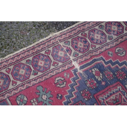 1044 - <strong>A Persian runner,</strong> having animal and fruit motifs to central field, with geometric b...