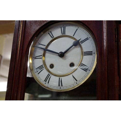 1053 - <strong>A circa 1900 mahogany wall clock,</strong> with enamel dial and spring driven movement,...