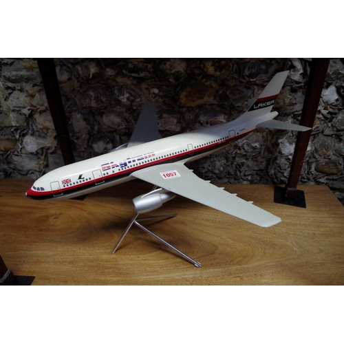 1057 - <strong>A model of a Laker A300 'Skytrain' aeroplane, </strong>wingspan 46cm, on stand....