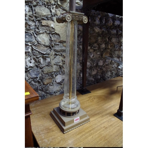 1059 - <strong>A brass and glass table lamp,</strong> total height 64cm....