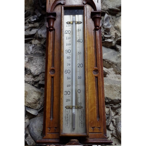 1064 - <strong>An oak aneroid banjo barometer, </strong>the silvered dial inscribed 'Negretti & Zambra,...