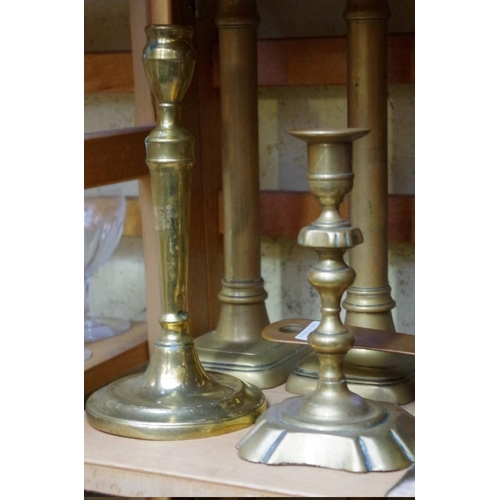 1082 - <strong>A collection of twelve 18th and 19th century brass candlesticks,</strong>to include tw...