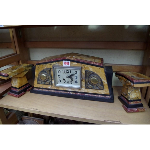 1086 - <strong>An Art Deco coloured marble and slate clock garniture,</strong> the clock 40cm wide, (s.d.)...