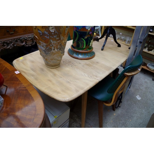 1115 - <strong>A vintage Ercol stripped elm and beech drop leaf dining</strong> <strong>table,</strong> 136...