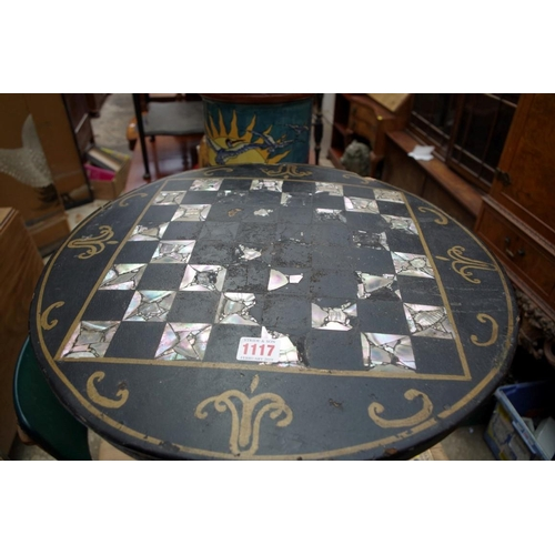 1117 - <strong>A Victorian papier-mache circular tripod table,</strong> the tilt top with chequerboard inla...