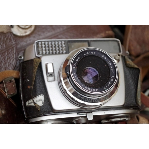 1197 - <strong>A quantity of 35mm and other cameras and equipment,</strong> to include a Yashica-A....