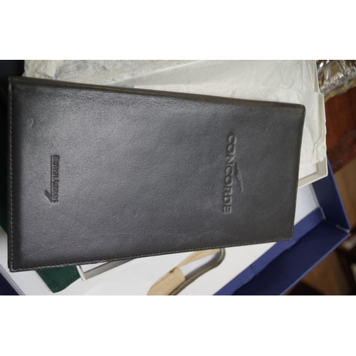 1250 - <strong>Concorde:</strong>two leather folders; stationary; a blank flight certificate; a brochure; ...