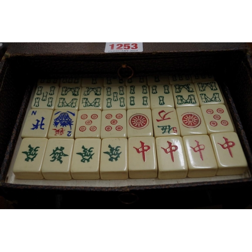 1253 - <strong>A old plastic mahjongg set.</strong>...