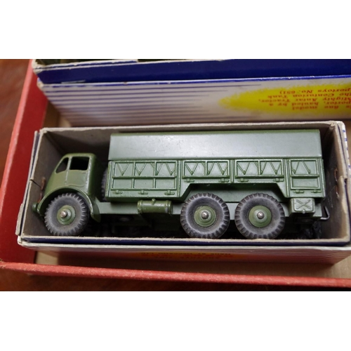 1257 - <strong>Three boxed Dinky Toys military vehicles, </strong>comprising: Tank Transporter, No.660...