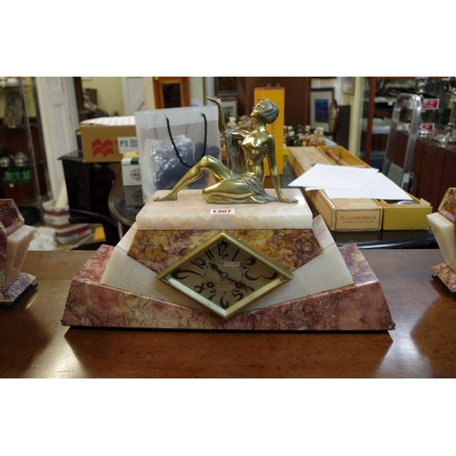1307 - <strong>An Art Deco marble, onyx and brass clock garniture,</strong> the clock 46cm wide....