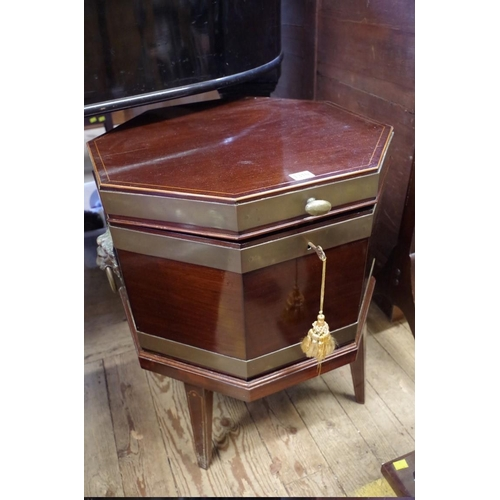 1310 - <strong>A George III mahogany line inlaid and brass bound octagonal cellarette on stand, </strong>53...