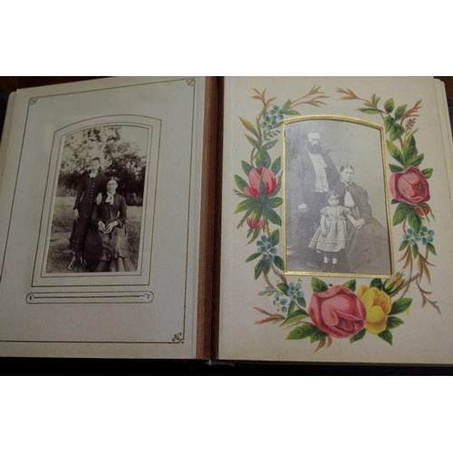 1377 - <strong>A Victorian album of black and white portrait photographs.</strong>...