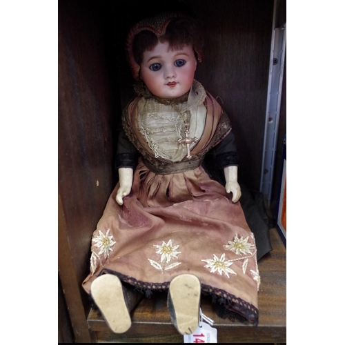 1449 - <strong>An SFBJ Unis 60 bisque head doll,</strong>42cm long.<strong><br /><br /></strong>...