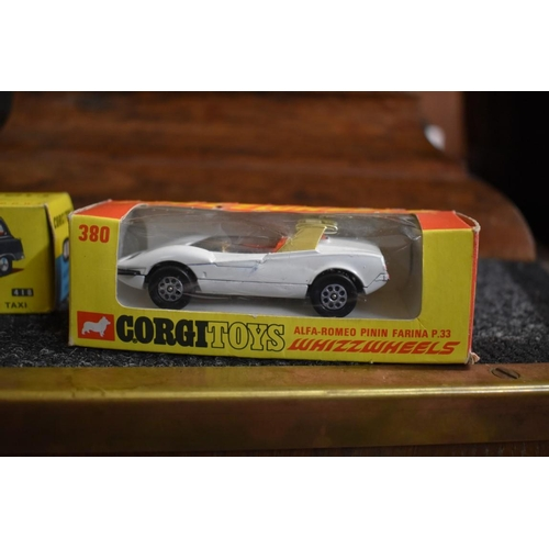 1492 - <strong>Three Corgi vehicles,</strong> comprising 418 Austin taxi; 380 Whizzwheels Alfa Romeo, and 2...