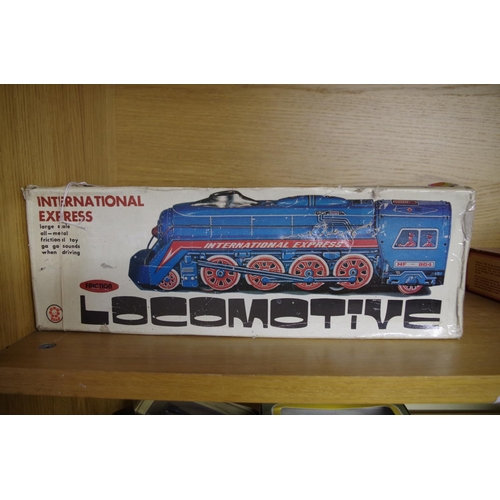 1592 - <strong>A 1960s tinplate 'International Express' Friction Locomotive,</strong>boxed....