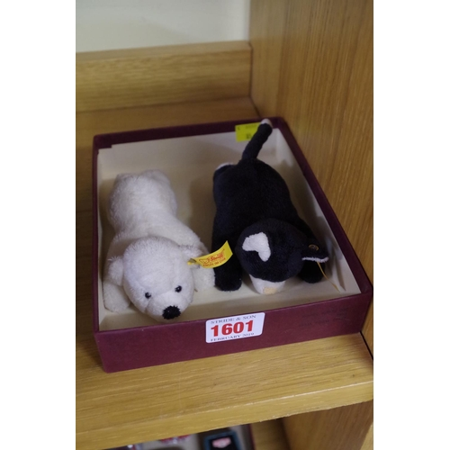 1601 - <strong>A Steiff polar bear and similar cat, </strong>each with magnetic paws. ...