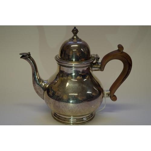 10 - <strong>A silver batchelor's teapot,</strong> <em>by Manoah Rhodes & Sons Ltd,</em> London 1926,...