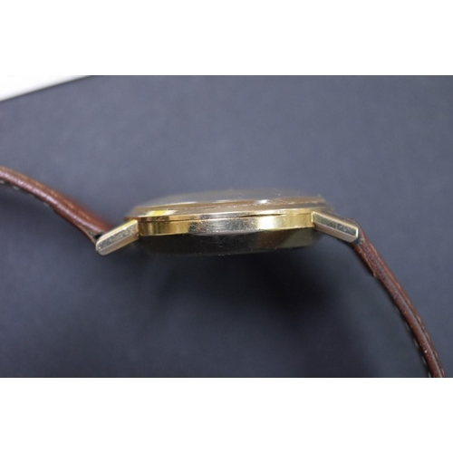 162 - <strong>A vintage Omega gold plated gentlemans automatic wristwatch,</strong>on leather strap, 35mm...