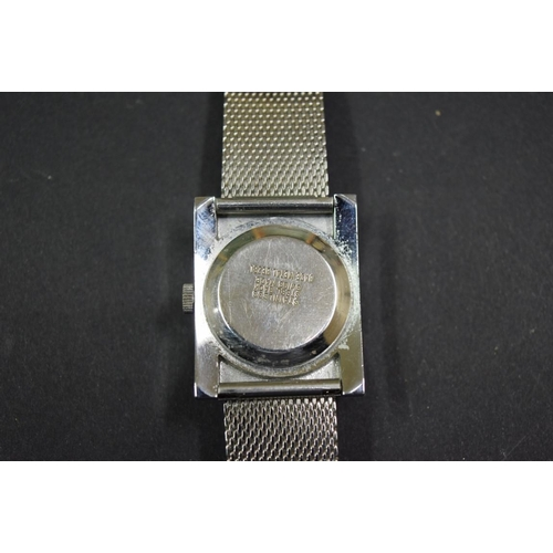165 - <strong>A vintage Sicura stainless steel jump hour digital watch</strong>, having 17 jewel manual wi...