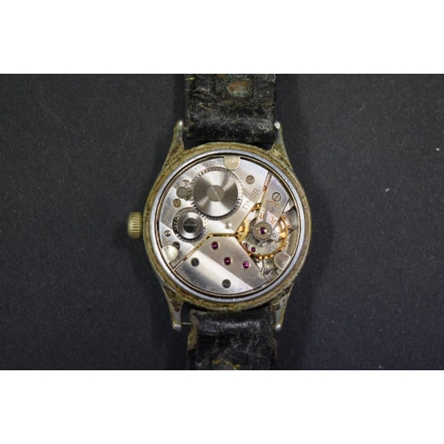 171 - <strong>A WWII Timor ATP military gentlemans watch,</strong> on leather strap, 30mm....
