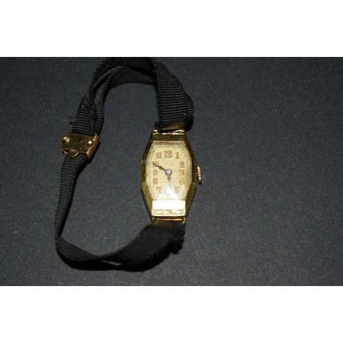 182 - <strong>A 1930s 18ct gold ladies wristwatch</strong>, having Swiss movement; together with a 9ct gol...