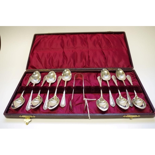 19 - <strong>A cased set of eleven silver teaspoons and matching sugar tongs,</strong><em>by W.S Savage ...