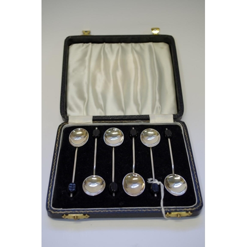 21 - <strong>A cased set of six silver coffee bean handled spoons,</strong> <em>by Alexander Clarke &...
