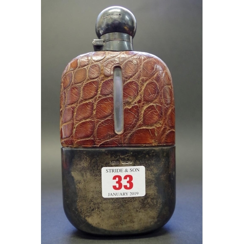 33 - <strong>An Edwardian silver and crocodile skin mounted glass hip flask</strong>, <em>by James Dixon ...