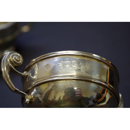 41 - <strong>A set of four silver twin handled salts,</strong> <em>by Carrington & Co</em>, London 19...