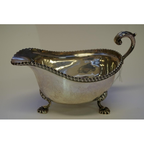 7 - <strong>A silver sauce boat,</strong><em>by Mappin & Webb,</em> Birmingham 1928, 11cm, 271...