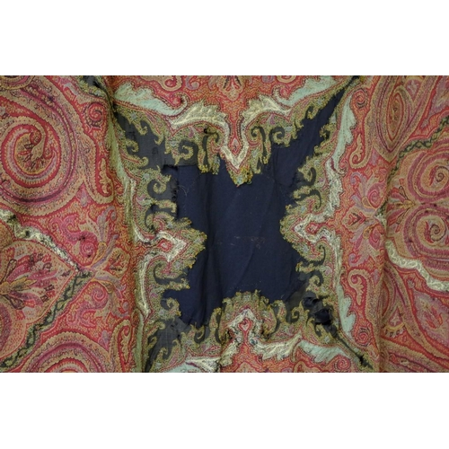 1049 - <strong>A 19th century Kashmiri hand stiched Paisley shawl,</strong> with decorative border, 197 x 1...