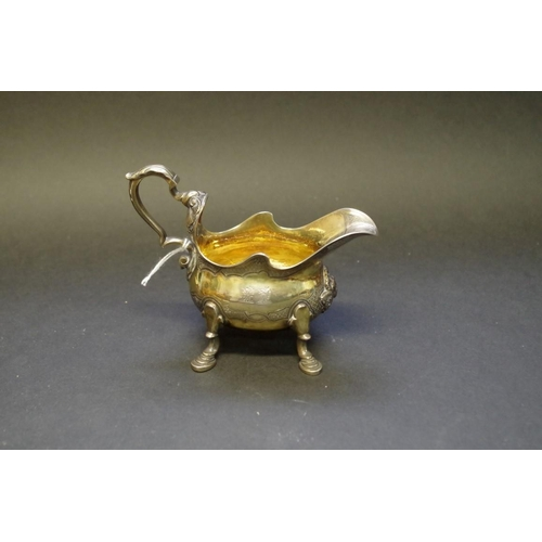 11 - <strong>A Victorian silver gilt creamer,</strong> <em>by Garrards,</em> London 1871, 10cm, 165g....
