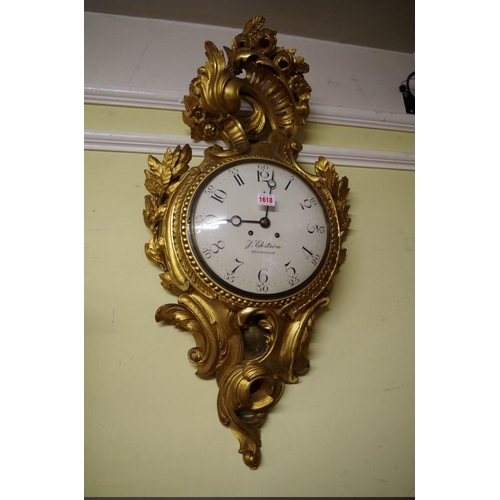 1618 - <strong>A Swedish rococo carved giltwood cartel clock,</strong>the 10in painted convex dial inscrib...