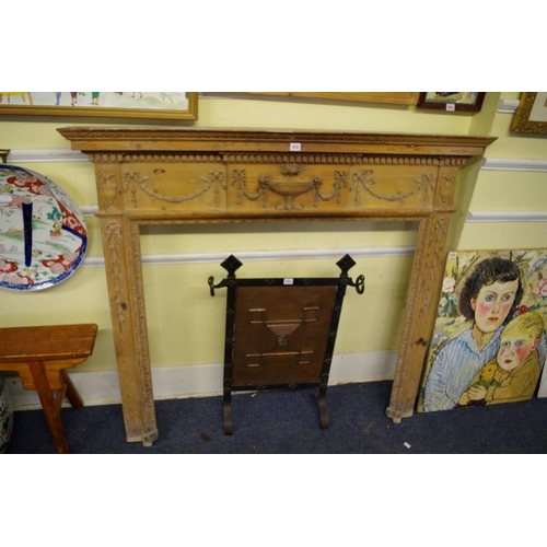 1630 - <strong>An antique neo-classical pine fire surround,</strong> 120cm high x 138cm wide, aperture 91.5...