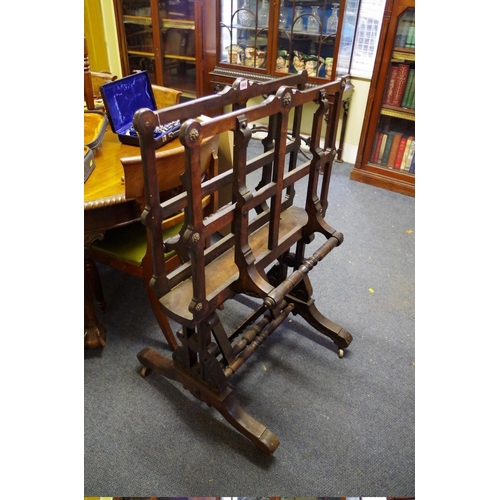 1655 - <strong>A Victorian stained wood folio stand,</strong>75cm wide....