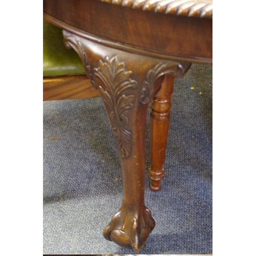 1656 - <strong>A Victorian mahogany extending dining table,</strong> with two leaf insertions, on cabriole ...