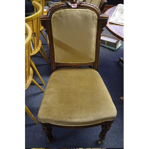 1664 - <strong>A set of four Victorian carved mahogany dining chairs, </strong>stamped 'Hewetson & Miln...