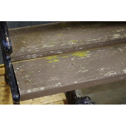 1666 - <strong>A Victorian cast iron and wooden slat bench,</strong>166.5cm wide....