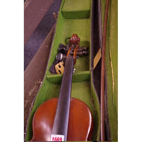 1669 - <strong>An antique Continental violin, </strong>with Stradivarius label, and 13in back, with associa...