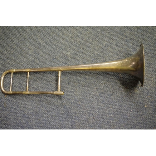1670 - <strong>A Boosey & Hawkes trombone </strong>No. 125176, in original brown leather case....