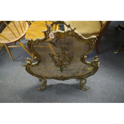 1671 - <strong>An antique rococo style cast brass fire guard,</strong>90cm high x 73cm wide....