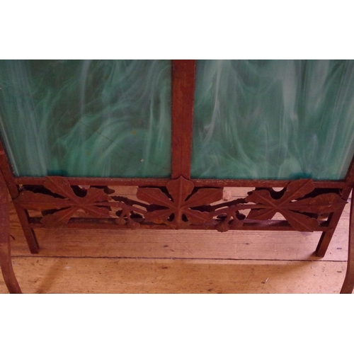 1675 - <strong>A French Art Nouveau wrought iron and marbled green glass fire screen, </strong>by Jean...