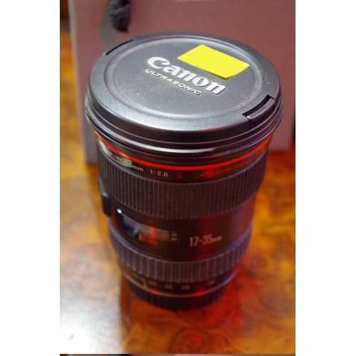 1689 - <strong>Cameras:</strong>aCanon EF 17-35 1:2.8 L lens, (red line), with dust bag....